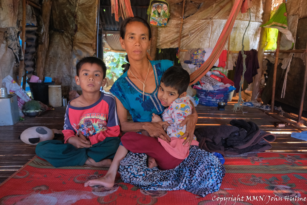 """Ma Phyu is a single mom of four children; her husband died when her youngest child was just 6 months old. Ma Phyu and her children crossed the border into Thailand in hope of working to save enough money to enable them to eventually return home to a better life and more stability. During COVID-19, there has been less work, and some days she has no work at all. She found a night shift job, but was unable to take it because she did not want to leave her children alone. Ma Phyu's second child, who is now 13 years old, was born with polio. Ma Phyu is therefore unable to take any job that is too far from her home. """"If there was a childcare centre in the workplace, it would help women to bring their children with them to work, and they would be able to concentrate on their work more, enabling them to earn more income. Ma Phyu receives eggs and rice every 15 days which helps a lot, but she still owes money to her relatives that she borrowed for daily expenses."""